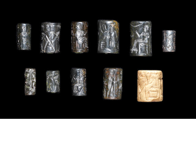A Collection of 11 Cylinder seals in presentation box and with paperwork