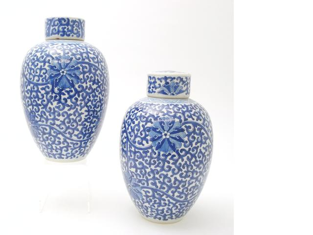 A pair of blue and white jars with covers Kangxi style but 19th century