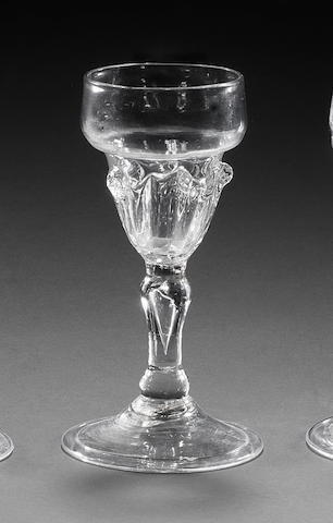 An unusual early baluster wine glass, circa 1690