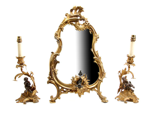 A 20th century rococo style gilt cast brass dressing table mirror