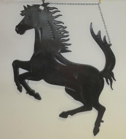 A Ferrari Prancing Horse garage display emblem,