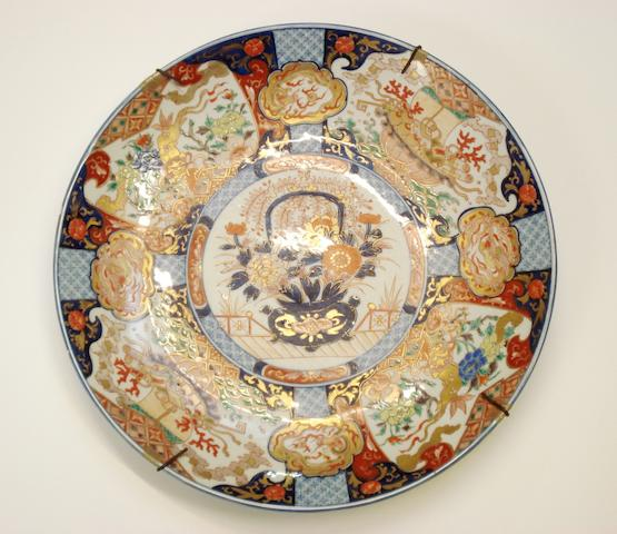 A large Imari charger and two smaller Circa 1900 and later