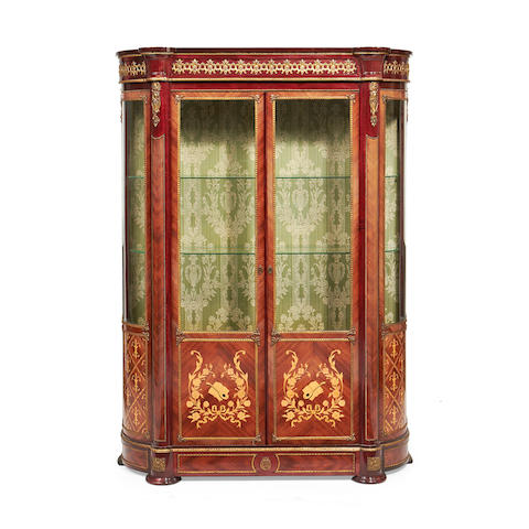 A brass mounted tulipwood, stained beech and marquetry vitrine in the Transitional style