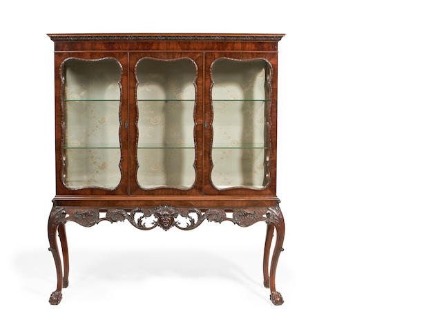 An Irish George III style mahogany display cabinet on stand