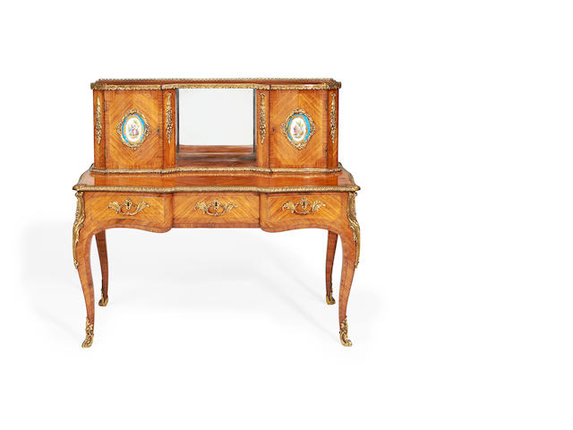 An early Victorian gilt metal and porcelain mounted tulipwood bonheur du jour in the Louis XV revival style