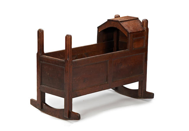 A mid-18th century oak cradle