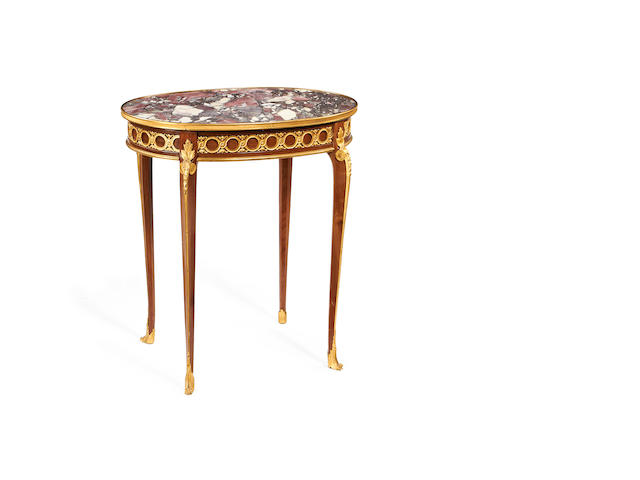 A French late 19th century Transitional style gilt bronze mounted gueridon by Soubrier