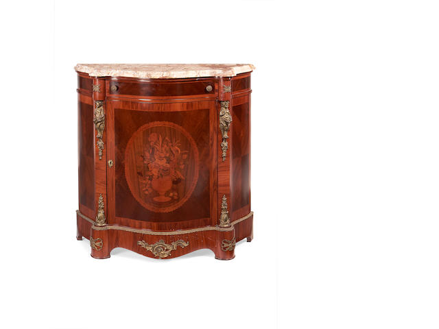 A Louis XV style tulipwood and marquetry serpentine side cabinet