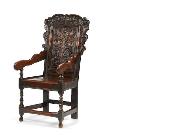 A Charles II oak panel back open armchair, circa 1680, Yorkshire