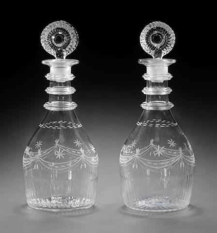 A pair of irish decanters and stoppers, inscribed MG