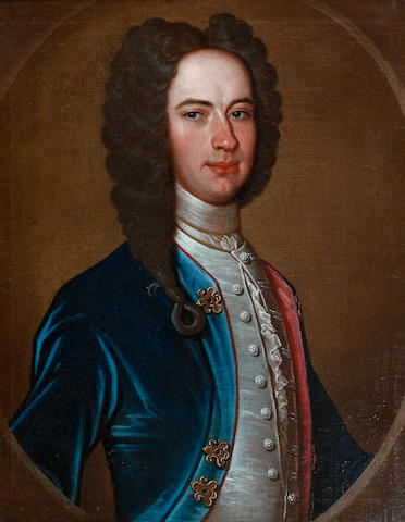 Richard Waitt (British, ?-1732) Portrait of a gentleman, half-length, in a blue velvet coat, within a painted oval