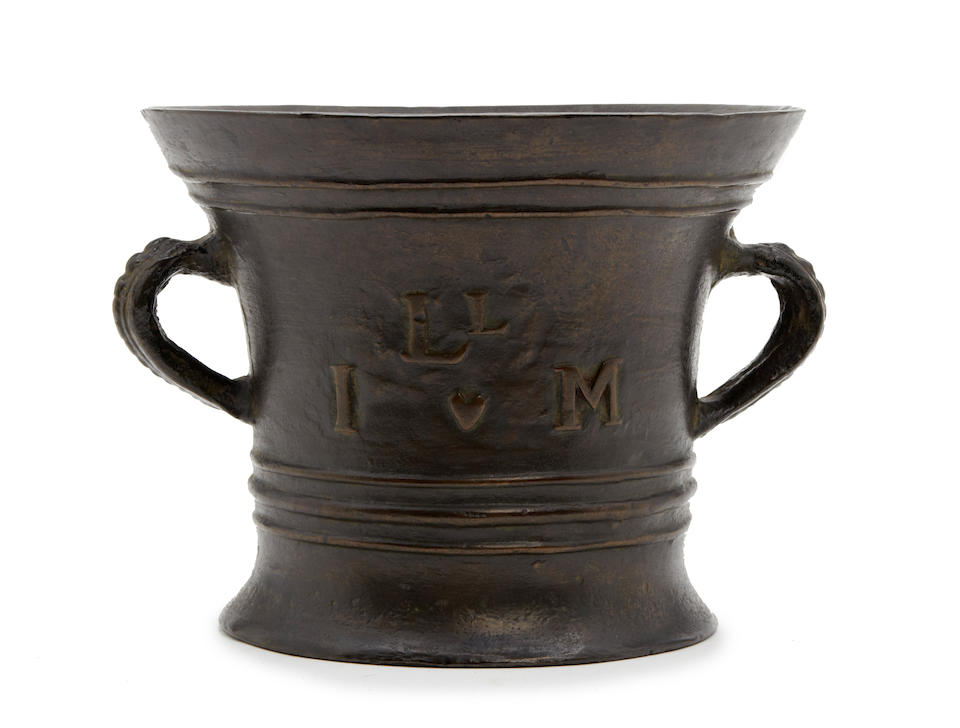 A large Queen Anne bronze alloy mortar, by Ralph Ashton (fl. 1703 - 1728) of Wigan, Lancashire