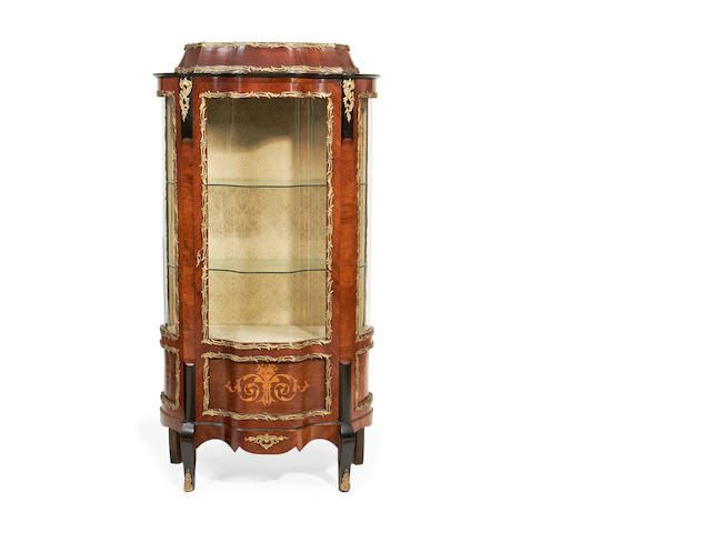 A late 19th/early 20th century brass mounted kingwood, ebonised and inlaid serpentine vitrine in the Louis XV style