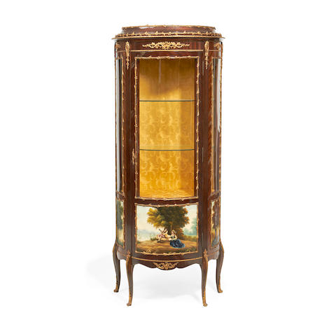 A Louis XV style gilt metal mounted mahogany and polychrome painted bowfront vitrine