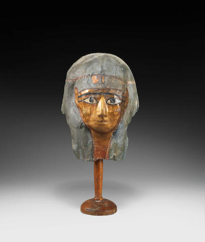 An Egyptian gilt cartonnage mummy mask