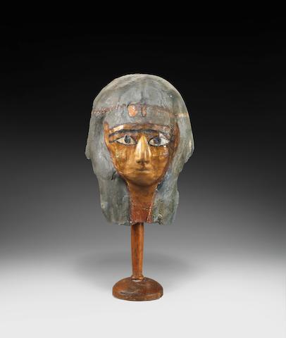 An Egyptian gilt cartonnage mummy mask