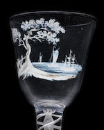 A Beilby enamelled wine glass with a coastal scene, circa 1765