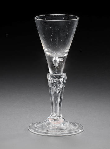 A George I commemorative pedestal-stem wine glass, circa 1715