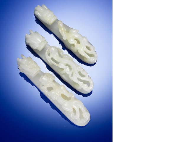 Three white jade 'chi dragon' belt hooks