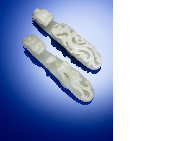 Two white jade 'chi dragon' belt hooks