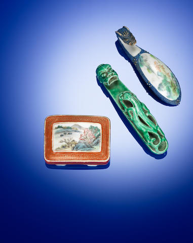 A moulded green ground and two famille rose enamelled porcelain belt buckle and belt hooks