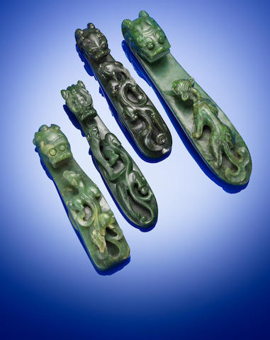 Four spinach green jade 'chi dragon' belt buckles Yuan/Ming dynasty