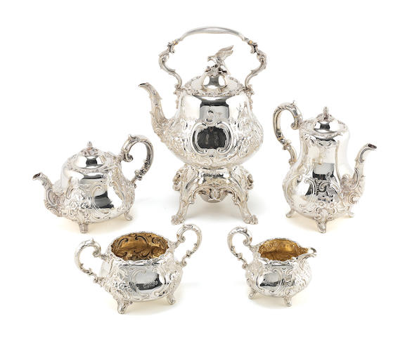 A five piece silver tea set by Goldsmiths 1887 & 1890 (ivory insulators).  Weight 150 ozs.