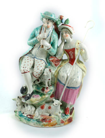 A pearlware figure group of shepherd and shepherdess Circa 1800