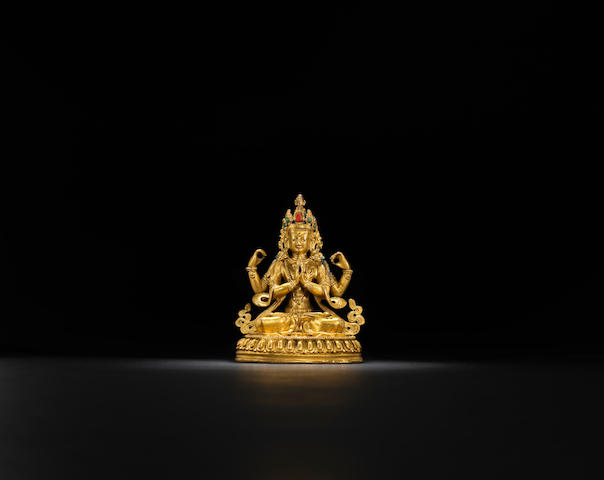 A gilt-bronze four-arm Guanyin Qing dynasty, 18th century