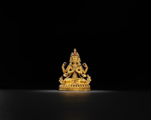 A gilt-bronze four-arm Guanyin Qing dynasty, 18th century