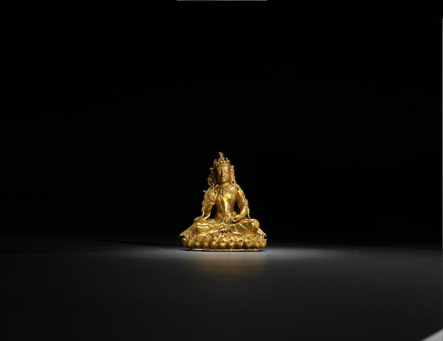 A gilt-bronze seated Guanyin Qing dynasty, 18th century