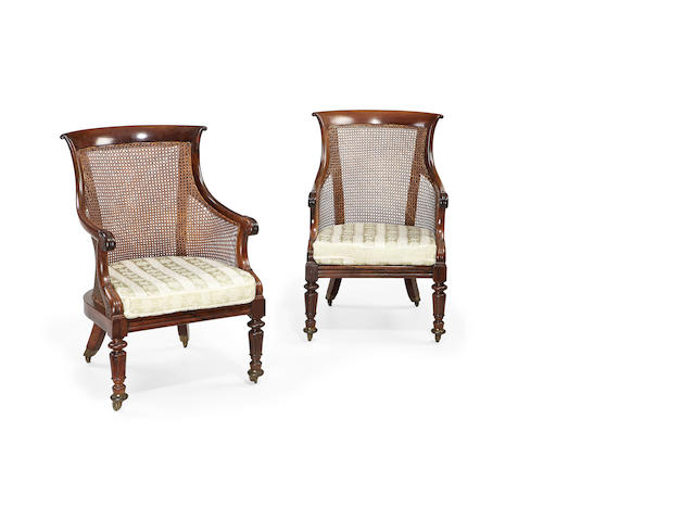 A pair of William IV rosewood library bergères in the manner of Wilkie & Cochran