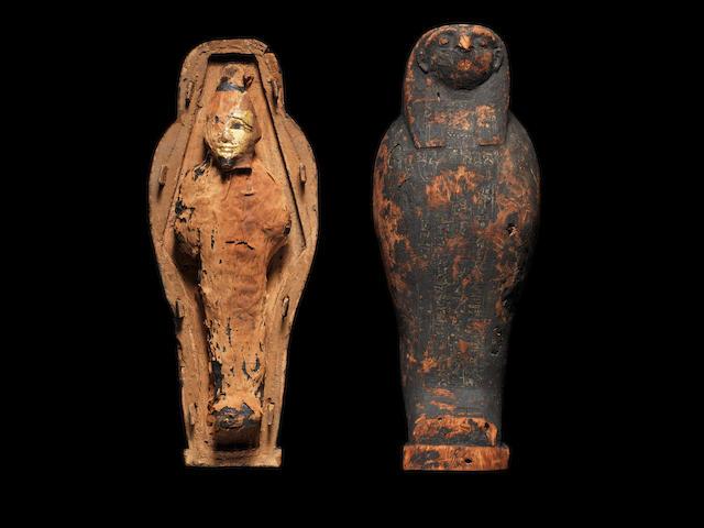 An Egyptian corn mummy and wood sarcophagus
