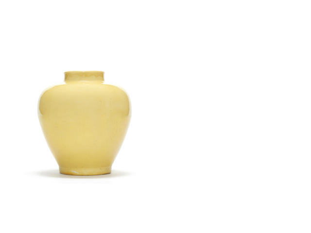 A Kangxi ovoid lemon yellow ground vase, marks and of period, later hardwood cover and stand
