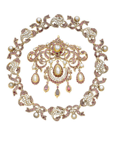 A silver gilt, pearl and garnet necklace and pendant, (2) (illustrated inside the back cover)