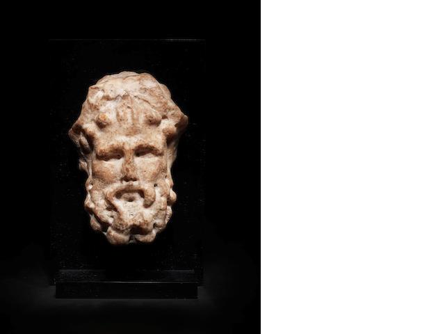 A Roman marble herm head of Dionysus
