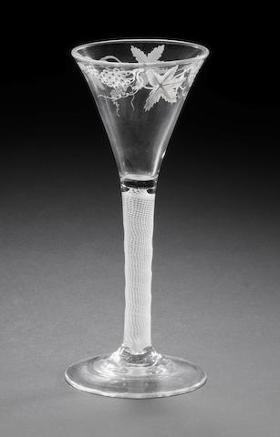 A Beilby enamelled wine glass