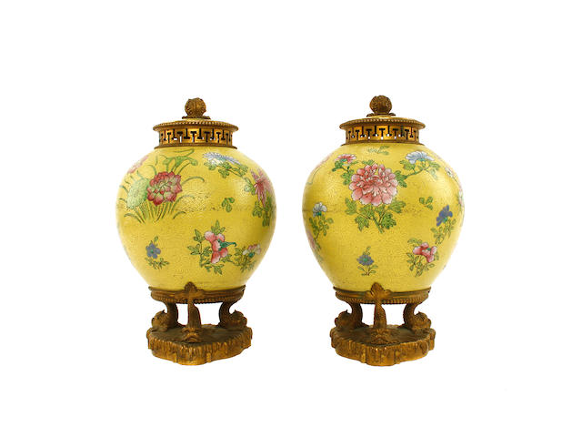 A pair of Chinese yellow ground vases and covers, late 19th/early 20th century