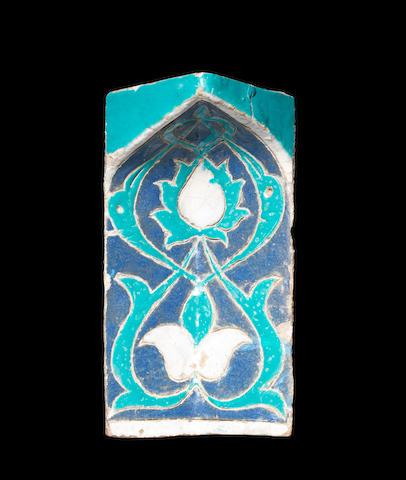 A Timurid polychrome pottery Niche Tile (muqarna) Samarkand, 14th Century