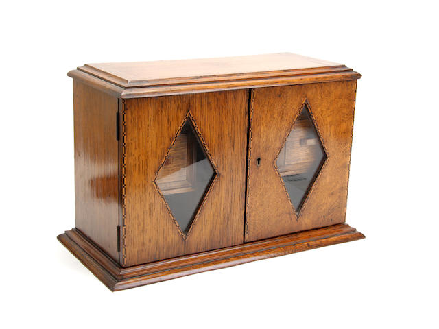 An Edwardian oak smokers cabinet