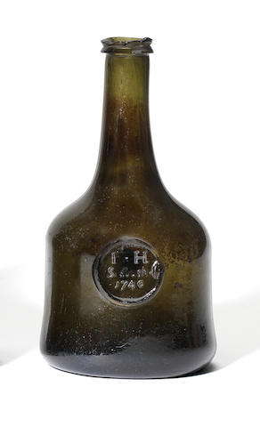 A sealed wine bottle, dated 1740