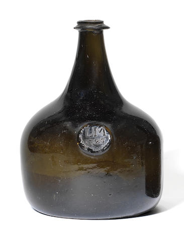 A sealed wine bottle, dated 1723