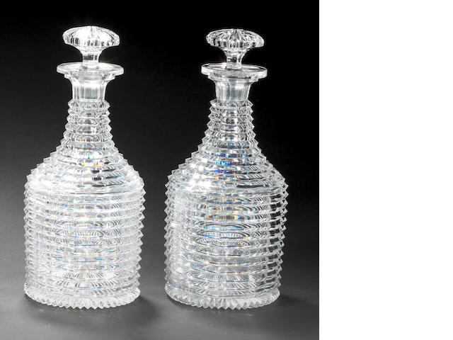 A pair of cut-glass decanters and stoppers, circa 1820