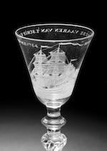 A Dutch engraved light baluster wine glass with ship portrait, manner of Sang, circa 1760