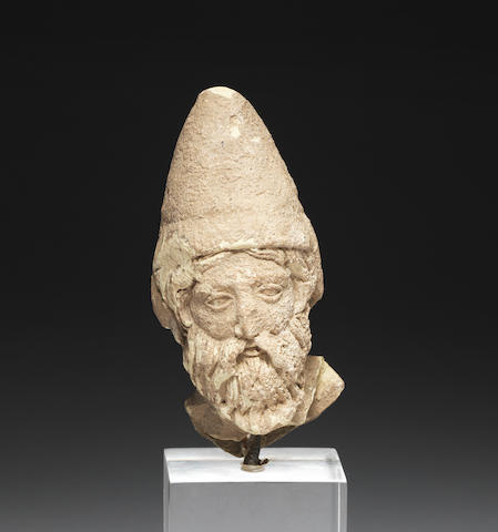 A Greek terracotta head of a bearded warrior