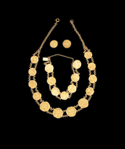 An Indian coin necklace, bracelet and earrings set