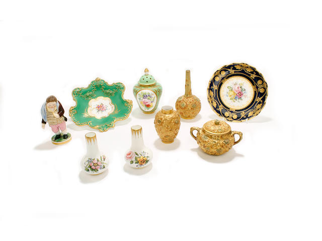 Three pieces of Derby Crown Porcelain repoussé ware, two Royal Crown Derby dishes and a Derby (King Street) figure, a pair of miniature vases and a vase and cover, early 20th century