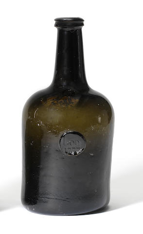 A sealed wine bottle, dated 1777