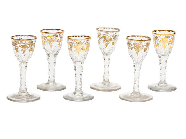 A set of six gilded facet-stem wine glasses, circa 1775-80