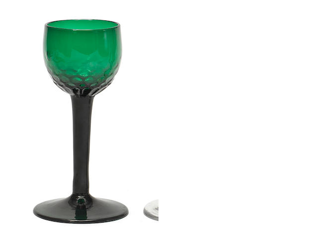 A plain-stem green-tinted wine glass, circa 1750